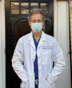 Image of Dr. Malin in doctor's coat and mask